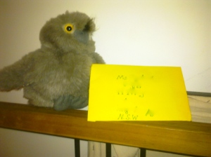 Photo of a toy owl delivering a yellow envelope.