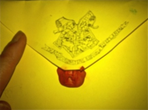 Photo of the back of an envelope sealed with red wax under the Hogwart's crest.
